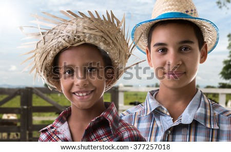 Brazilian boys on caipira costume on the farm