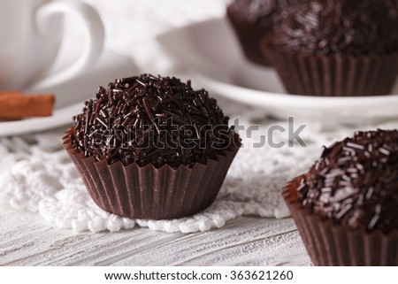 Brazilian Brigadeiro sweet and coffee on a table close-up. Horizontal