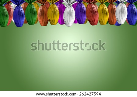 Brazilian Easters eggs hanging, on a green background. - stock photo