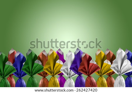 Brazilian Easters eggs, on a green background. - stock photo