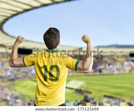 Brazilian fan celebrates on the stadium - stock photo