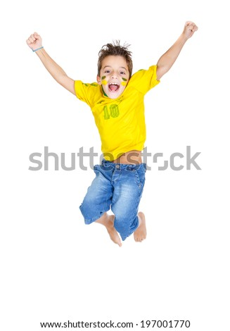 Brazilian fans Kid jumping and supporting Brazil for popular sports competitions, like soccer, volleyball - stock photo