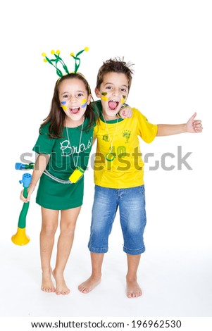 Brazilian fans Kids supporting Brazil for popular sports competitions, like soccer, volleyball  - stock photo