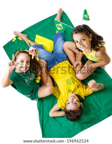 Brazilian fans Kids supporting Brazil for popular sports competitions, like soccer, volleyball and olympics. - stock photo