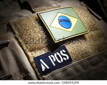 Brazilian flag and blood type IR patch on plate carrier  - stock photo