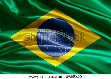 Brazilian flag fabric with waves - stock photo