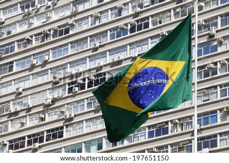 brazilian flag with building in background - stock photo