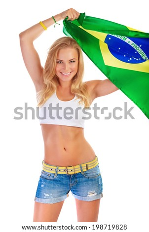 Brazilian football team supporter, portrait of attractive female raised up and holding in hands big Brazil flag isolated on white background - stock photo