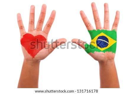 Brazilian hands with a painted heart and brazilian flag, i love brazil concept, isolated on white background - stock photo
