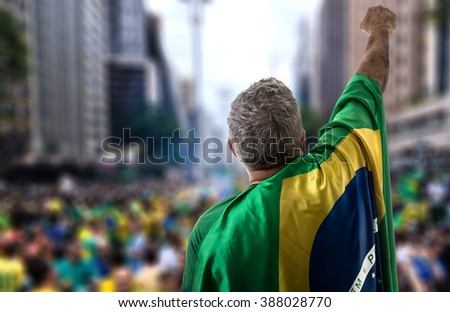 Brazilian holding the flag of Brazil in Paulista Avenue - stock photo