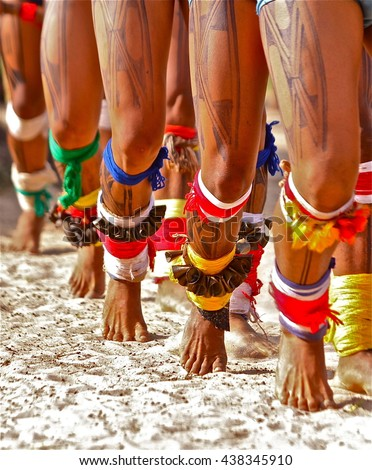 Brazilian Indians of the tribe Xingu dancing during Kuarup ritual. spiritual celebration that marks the death of a member of the village - stock photo