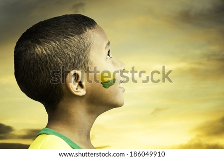 Brazilian little boy looks to the beautiful sky - stock photo