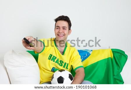 Brazilian man loves watching soccer - stock photo