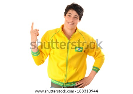 Brazilian man pointing up.  Attractive football fan with Brazil flag on his yellow sport blouse. Isolated on white. - stock photo