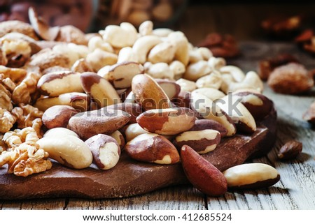 Brazilian nut, nut mix, vintage wooden background, selective focus