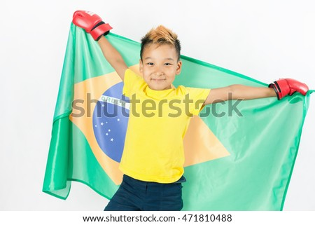 Brazilian patriot and fan boy holding Brazil flag. Box, boxing championship. Support. White background