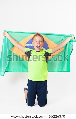 Brazilian patriot and fan boy holding Brazil flag. Football or soccer championship. Support. White background