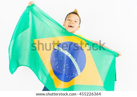 Brazilian patriot boy holding Brazil flag. Football or soccer championship. Support fan. White background