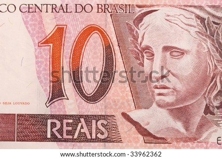 Brazilian Real currency on white .