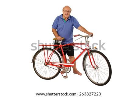 Brazilian senior riding an antique bike isolated on white background - stock photo
