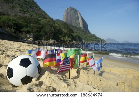 Brazilian soccer ball with international football flags on Praia Vermelha Red Beach at Sugarloaf Mountain Rio de Janeiro Brazil - stock photo