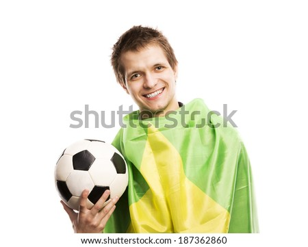 Brazilian soccer fan holding ball and flag of Brazil, isolated on white background