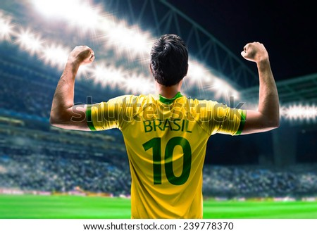 Brazilian soccer player celebrates in the stadium - stock photo