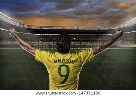 Brazilian soccer player, celebrating with the fans. - stock photo