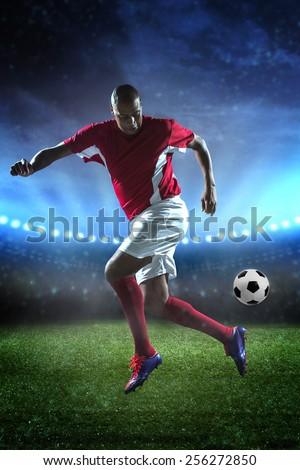 Brazilian soccer player kicking a ball - stock photo
