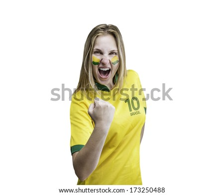 Brazilian woman celebrates on white background with her face painted - stock photo