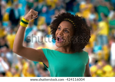 Brazilian woman fan celebrating in the stadium - stock photo
