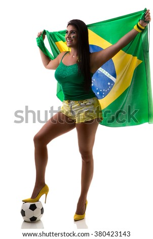 Brazilian woman fan holding the flag of Brazil