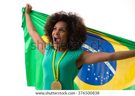 Brazilian woman holding the Brazilian flag on white background