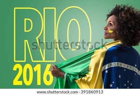 Brazilian woman holding the flag of Brazil and the Text: Rio