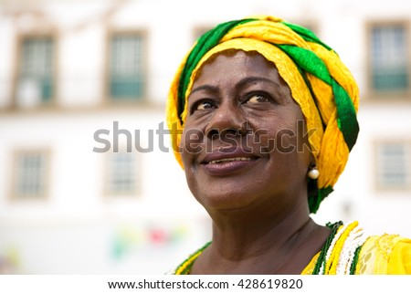 Brazilian woman wearing traditional clothes from Bahia in the old colonial district of Salvador (Pelourinho) - stock photo