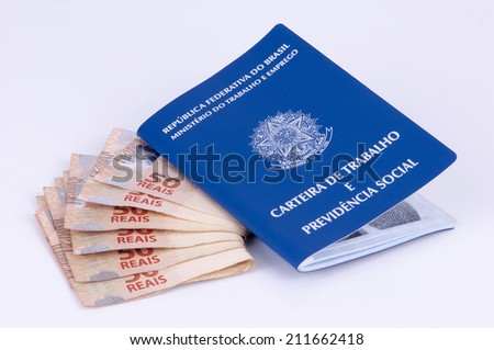 Brazilian work document and social security document (carteira de trabalho) and brazilian currency (Real) on white background - stock photo