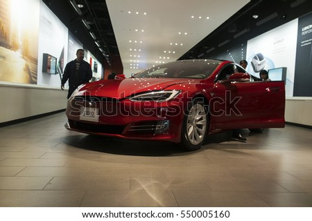 Brea, CA, USA - December 24, 2016: Entrance to Tesla showroom with Model S at Brea Shopping Center. Tesla Motors, Inc. is an American public company designs, manufactures, and sells electric cars.