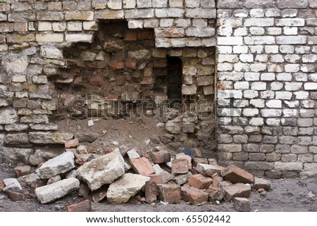 breach in the brick wall - stock photo