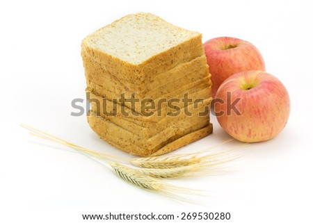 bread and apple isolated on white background,focus on bread - stock photo