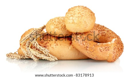 bread and buns with sesame seeds and spikelets isolated on white - stock photo