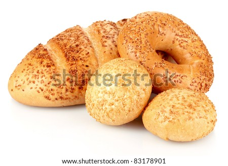 bread and buns with sesame seeds isolated on white - stock photo