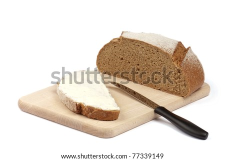 bread and butter on the wooden board isolated on white - stock photo