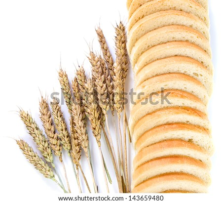 Bread and cereal ears on a white background.