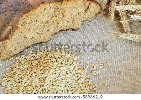 Bread and cereals on the burlap background - stock photo
