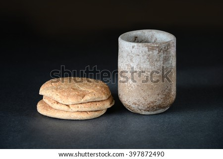Bread and cup of wine as symbols of Communion on table - stock photo