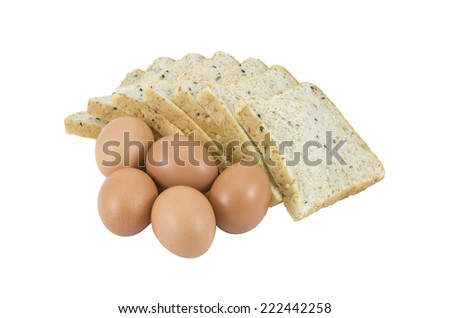 bread and eggs isolated in white - stock photo
