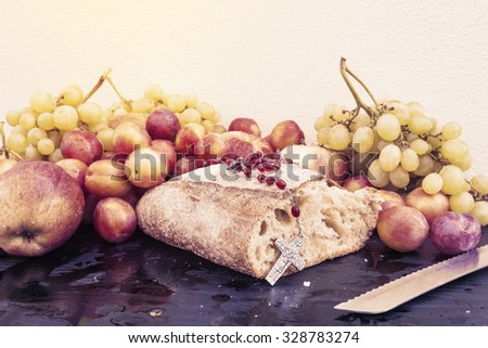 bread and grapes on white wall background - stock photo