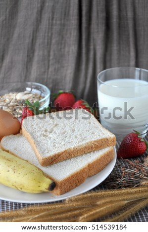 Bread and milk with fresh fruits for healthy breakfast