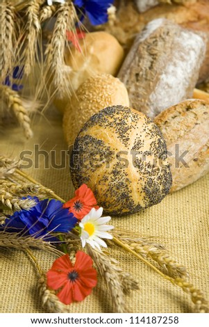 Bread and rolls with corn and field flowers