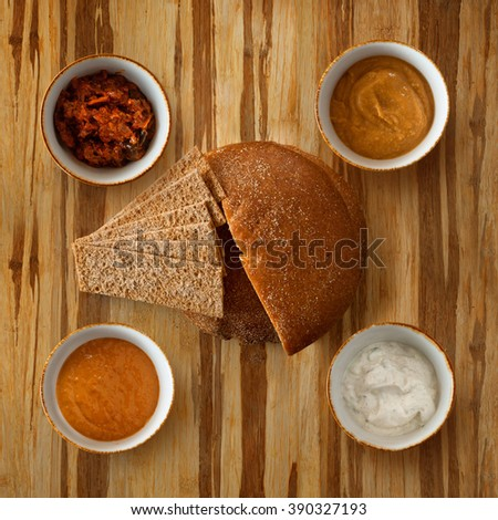 bread and spices on wooden table surface